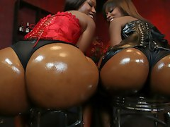 Two luscious black bubble butts tag-team big cock